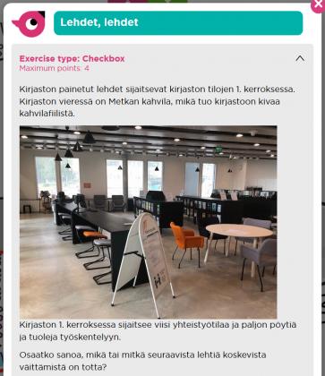 Kuvakaappaus etänä pelattavan Seppo-pelin tehtävästä. Tehtävässä on valokuva kirjaston tilasta Metrka-cafén vierestä, jossa sijaitsevat kirjaston painetut lehdet.