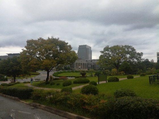 Trees, park, road, campus building.